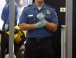 PHOTO: A TSA agent waits for passengers to pass through a magnetometer at Los Angeles International Airport in this Nov. 22, 2010 file photo in Los Angeles, Calif.