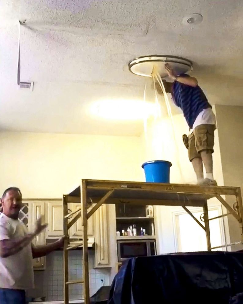 PHOTO: Carlos and Ebony January said a stream of water burst through a light fixture in their rental home after Waypoint did a poor job repairing a water leak.