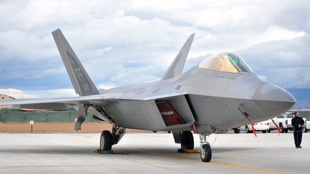 PHOTO: An Air Force F-22 Raptor sits in front of the new Fuel Composite Overhaul Test Facility at Hill Air Force Base, Utah.