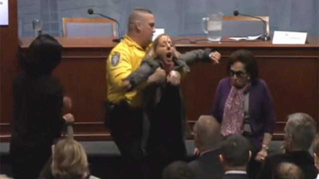 PHOTO: C-SPAN cameras captures a protester who interrupted John Brennan's speech defending the U.S. drone campaign against Taliban and al Qaeda militants, April 30, 2012.