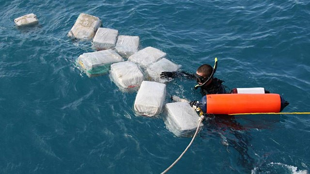 PHOTO:Diver recovering bales of cocaine