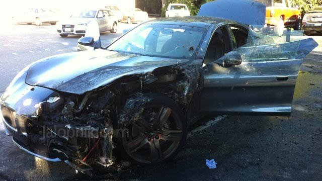 PHOTO: A Fisker Karma hybrid-electric luxury sedan set itself on fire as the owner was buying groceries.