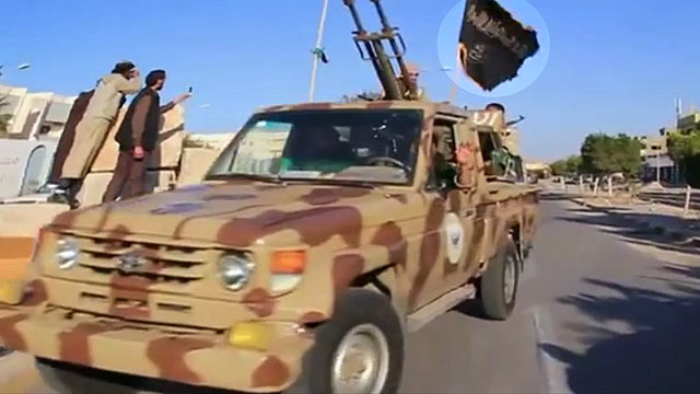 PHOTO: A new video purports to show al Qaeda flags flown by Libyan police and military vehicles in Sirte, Libya.