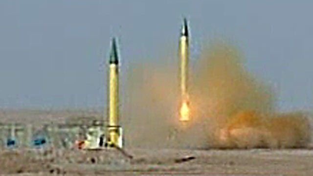 PHOTO: Irans Islamic Revolution Guards Corps shot off missiles during a televised military drill.