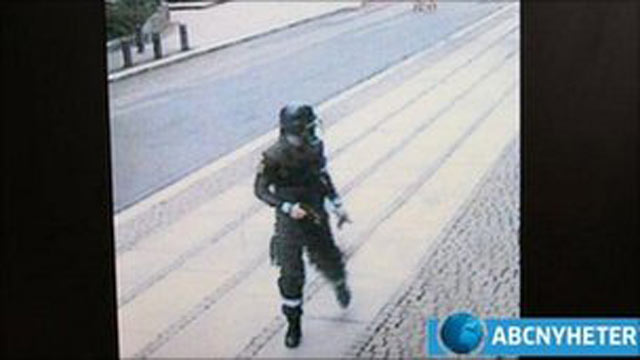 PHOTO: Anders Behring Breivik is filmed by CCTV cameras wearing a police uniform and holding a gun as he walks away from a car after placing a bomb in Oslo.