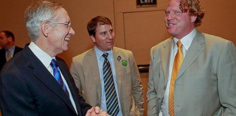 PHOTO: Sen. Harry Reid, left, seen with John Pappas, center, and Jeremy Johnson, right, in 2010.