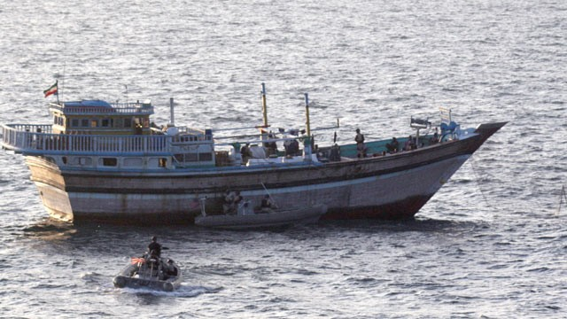 A Sailor aboard a safety boat observes a visit, board, search and seizure team assigned to the guided-missile destroyer USS Kidd (DDG 100) board the Iranian-flagged fishing dhow Al Molai, Jan. 5, 2012. (U.S. Navy)