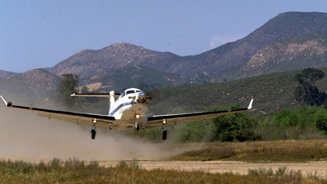 PHOTO: A U-28A plane, painted in a civilian paint scheme, is seen about to touch down on a landing strip, in this file photo.