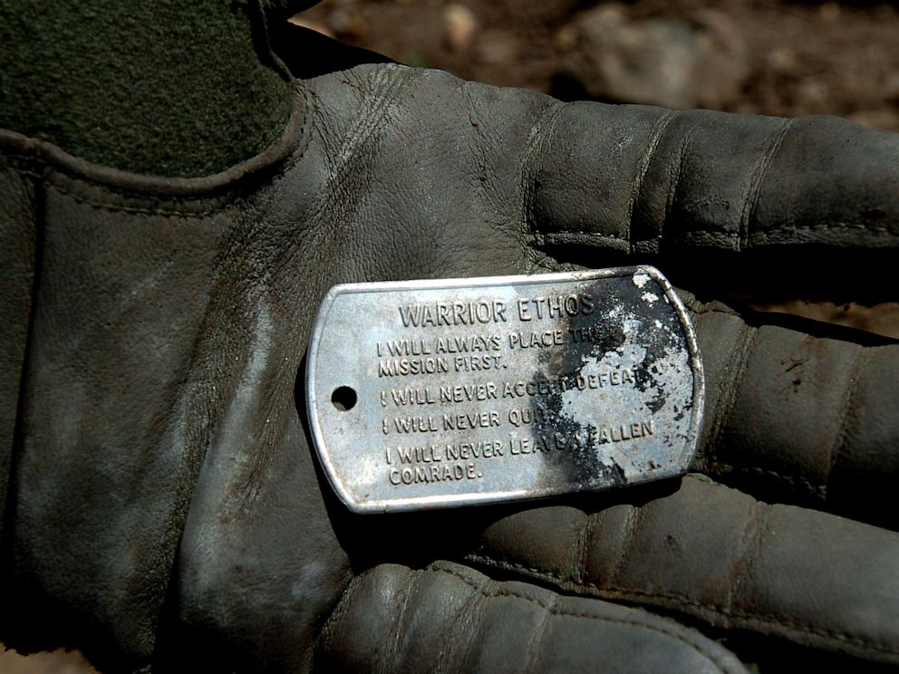 PHOTO: A dog tag with the Warrior Ethos inscribed on it, discovered in the wreckage of a shot down MH-47 helicopter in Operation Red Wings on June 28, 2005.