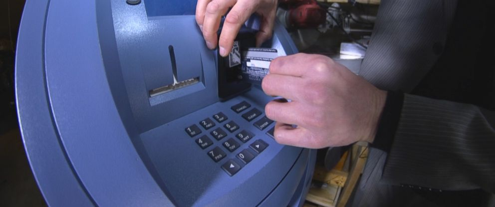 PHOTO: Cyber-crime expert Robert Siciliano shows how thieves can use a skimmer on an ATM to steal credit card information.