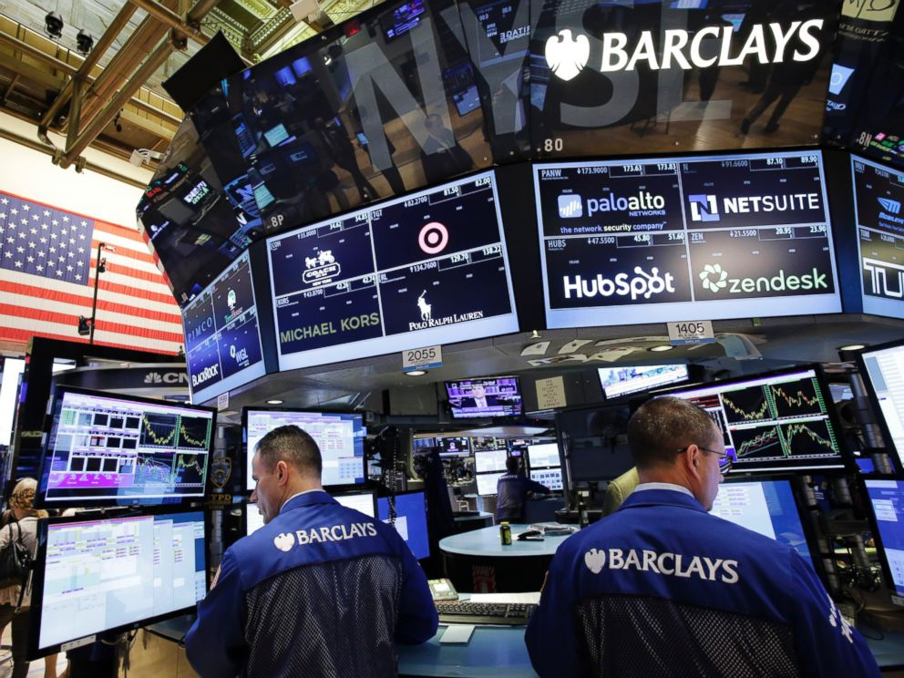 PHOTO: Traders with Barclays work at the New York Stock Exchange, July 6, 2015. World markets are trending downward following Greeces no vote in Sundays debt referendum.