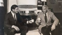 PHOTO: This 1977 photo provided by the Marotta family shows Vincent Marotta, left, and Joe DiMaggio sitting on a large Mr. Coffee machine in Chicago.