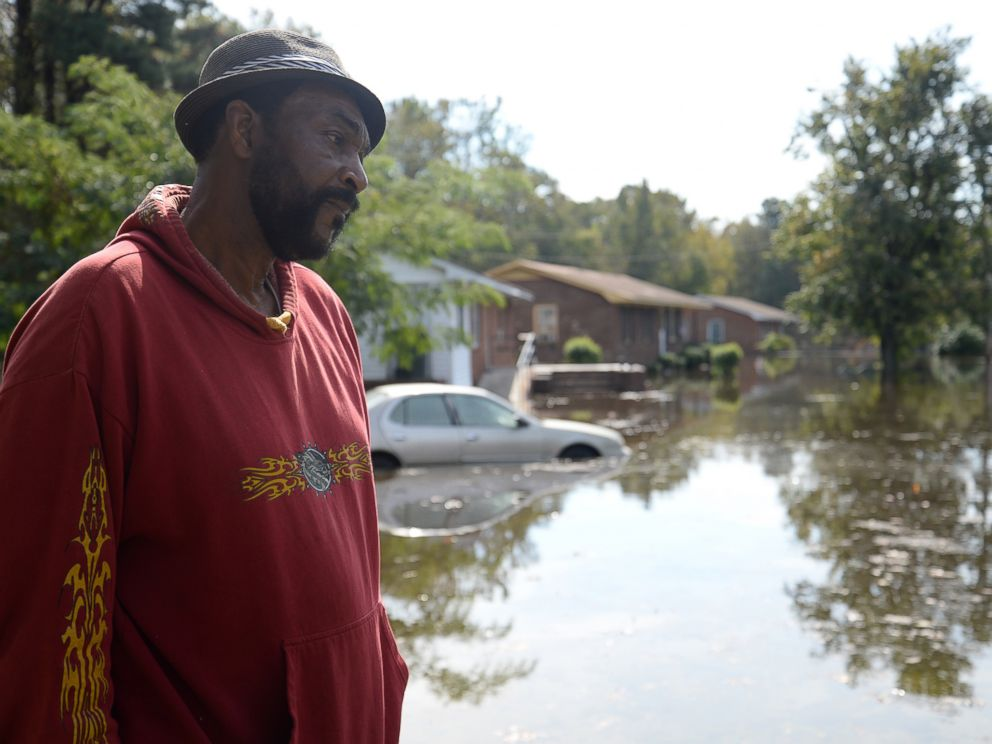 PHOTO: William Murrell stands at the edge of his property, which is partially underwater, due to Hurricane Matthew, on Cedar Lane in Kinston, N.C. , Friday, Oct. 14, 2016.