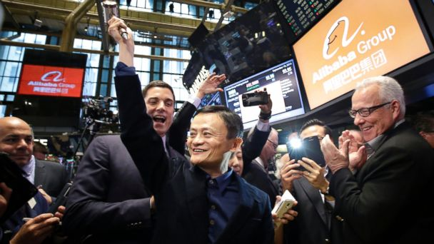 PHOTO: Jack Ma, center, founder of Alibaba, raises a ceremonial mallet before striking a bell during the companys IPO at the New York Stock Exchange, Sept. 19, 2014 in New York.