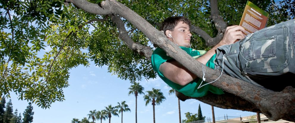 PHOTO: A mechanical engineering major reads between classes at Arizona State University, Oct. 27, 2010.