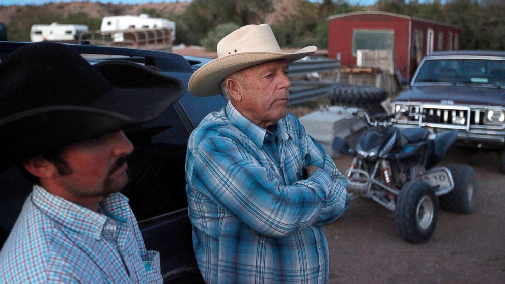 PHOTO: Cliven Bundy, right, and Clance Cox, left, stand at the Bundy ranch near Bunkerville Nev. Saturday, April 5, 2014.