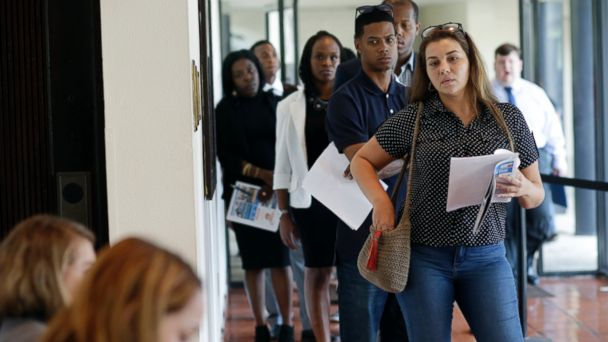 PHOTO: Raisa Rickie waits in line to apply for a job with Aldi at a job fair in Miami Lakes, Florida, July 19, 2016.
