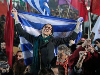 PHOTO: A supporter of Alexis Tsipras, leader of the left-wing Syriza party holds a Greek flag