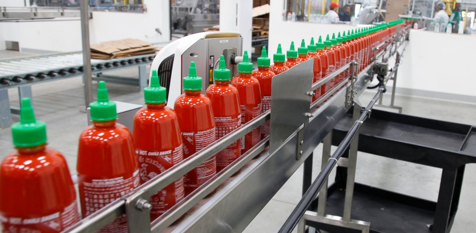 PHOTO: Sriracha chili sauce moves along a production line during at the Huy Fong Foods factory in Irwindale, Calif., Oct. 29, 2013.