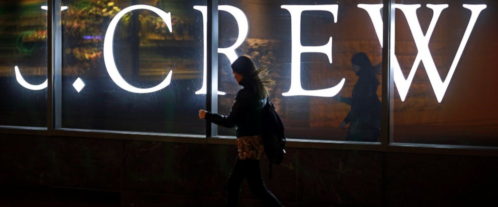 PHOTO: A woman walks past a J. Crew retail store in Baltimore, April 15, 2013.