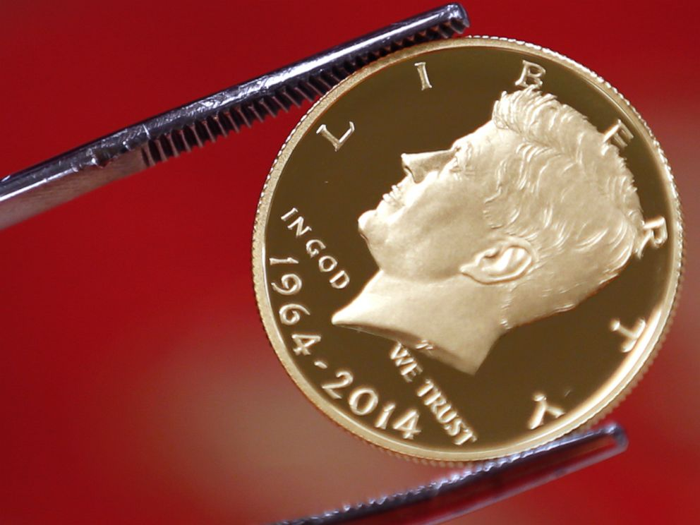 PHOTO: A newly-stamped gold coin of President John F. Kennedy is examined at the U.S. Mint at West Point on July 22, 2014 in West Point, N.Y.