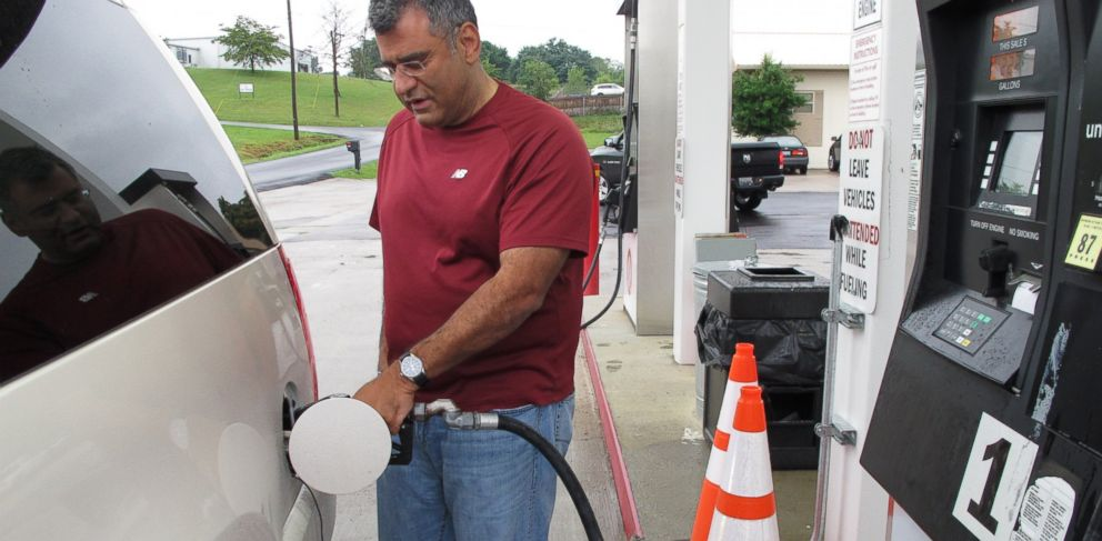 PHOTO: Samir Cook fills up his vehicle at a city-run station in Somerset, Kentucky, July 19, 2014.