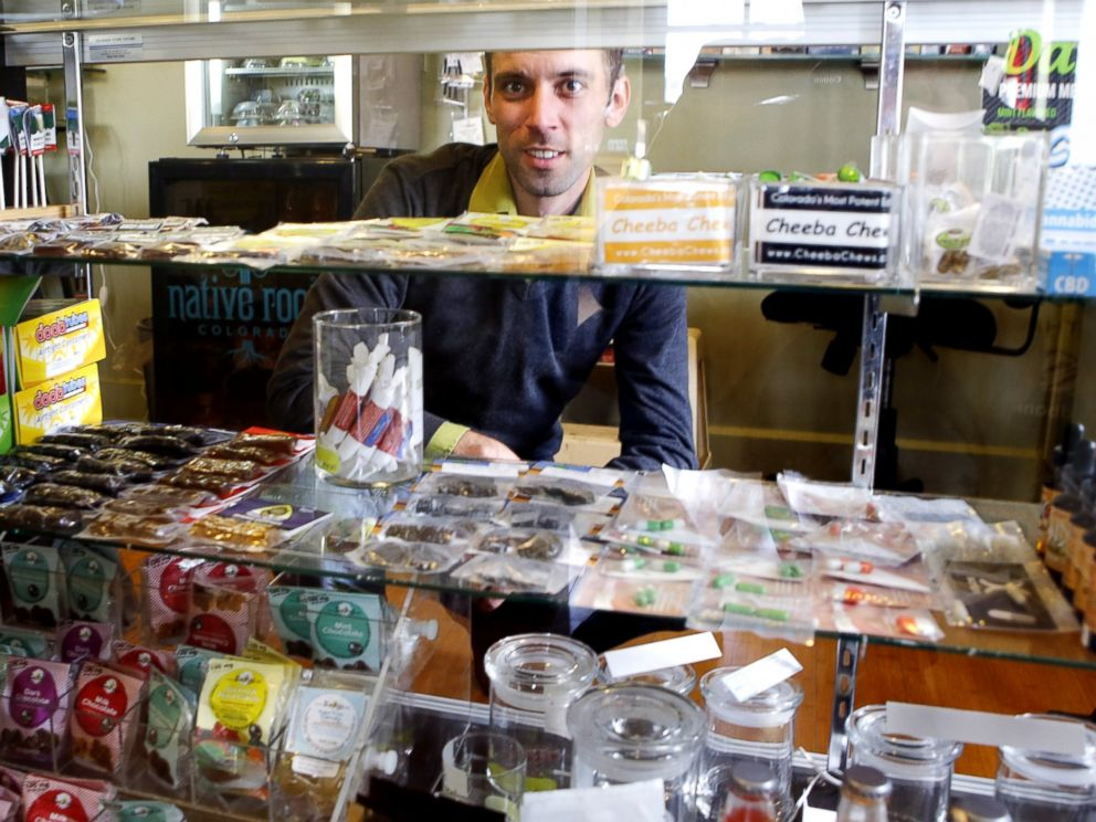 PHOTO: This April 11, 2013 photo shows Matt Brown, co-owner of Denvers new My 420 Tours, looking over a sampling of marijuana edibles at a dispensary in Denver.