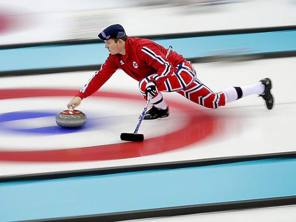 PHOTO: Norways Christoffer Svae delivers the stone during the mens curling training session at the 2014 Winter Olympics, Feb. 9, 2014, in Sochi, Russia.