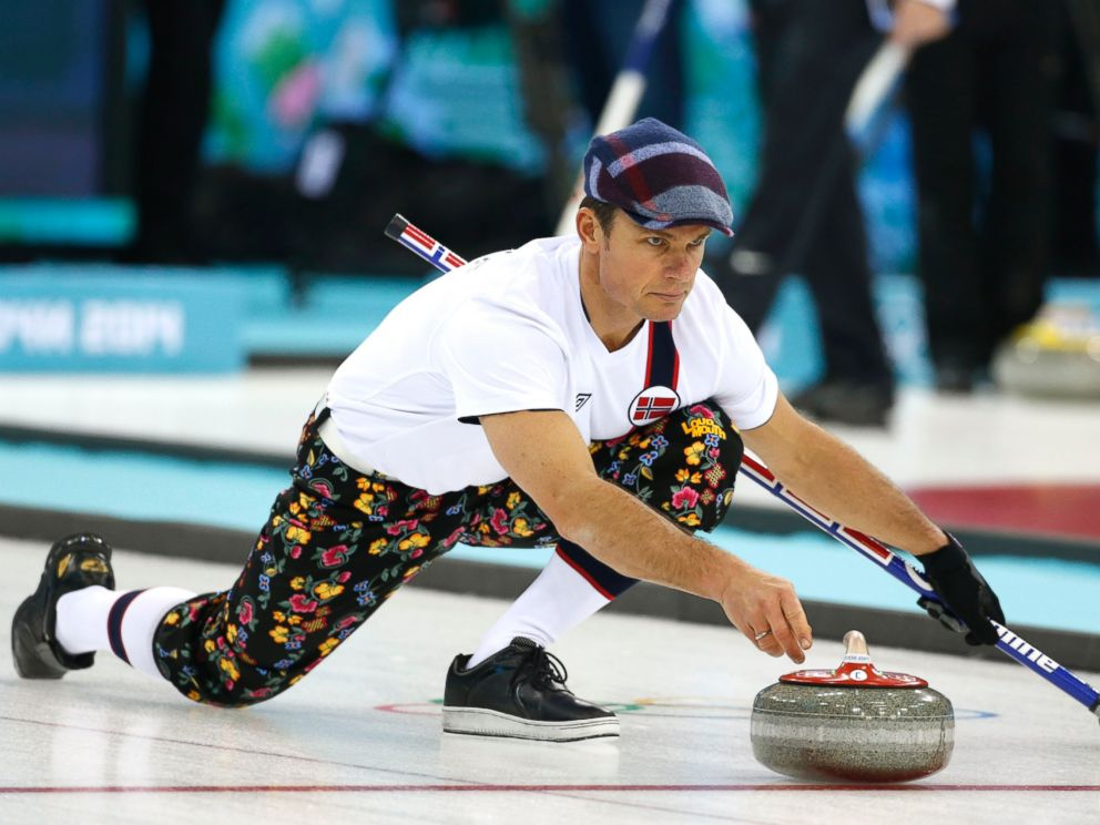 PHOTO: Norway skip Thomas Ulsrud, wearing rose-painting knickers and a patterned flat cap, delivers the stone during curling training at the 2014 Winter Olympics, Feb. 8, 2014, in Sochi, Russia.