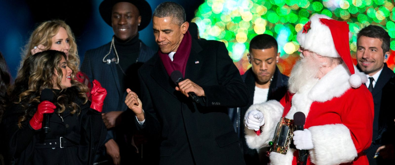 how not to embarrass yourself at the company holiday party abc news photo president barack obama dances on stage during the national christmas tree lighting ceremony at
