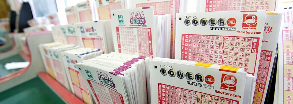 PHOTO: Powerball tickets, right, along with other lotto tickets are seen May 16, 2013, at a convenience store in Orlando, Fla.