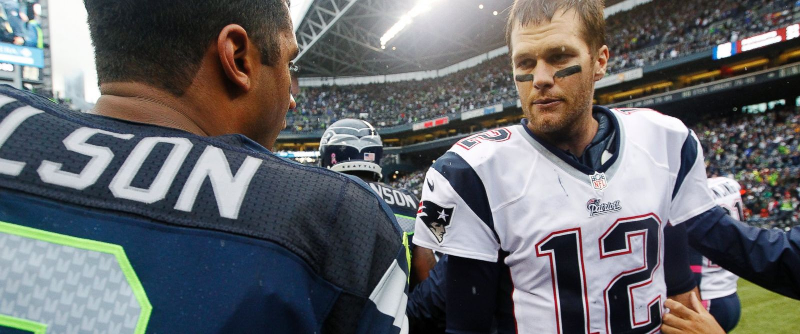 PHOTO: In this Oct. 14, 2012, file photo, New England Patriots quarterback Tom Brady talks with Seattle Seahawks quarterback Russell Wilson after an NFL football game in Seattle.