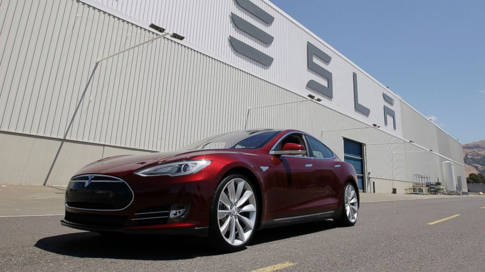 PHOTO: A Tesla Model S sits outside the Tesla factory in