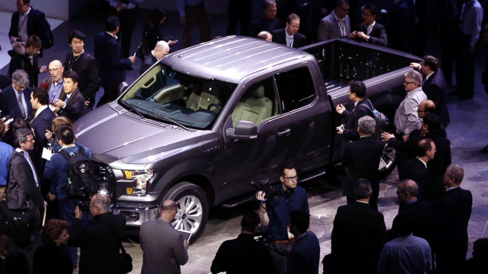 PHOTO: Journalists surround the new F-150 with a body built almost entirely out of aluminum at the North American International