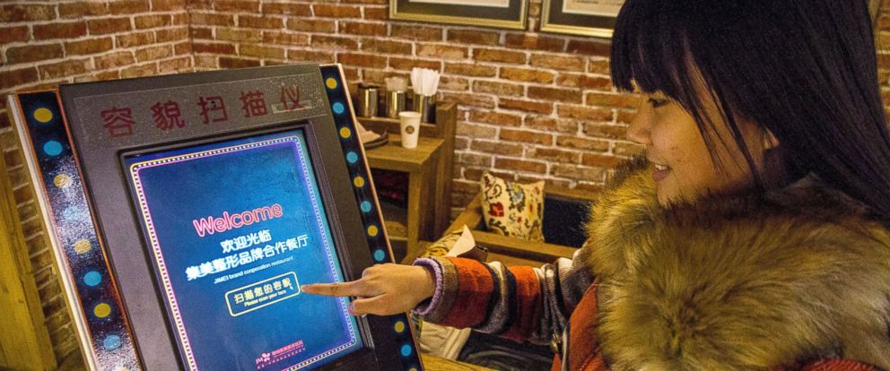 PHOTO: A customer uses a face-scanning machine at a restaurant offering free meals to customers who earn high marks for their looks in Zhengzhou city, China, Jan. 11, 2015.