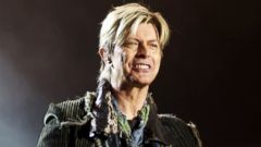 """PHOTO: David Bowie performs on stage on the third and final day of """"The Nokia Isle of Wight Festival 2004"""" at Seaclose Park, June 13, 2004, in Newport, UK."""