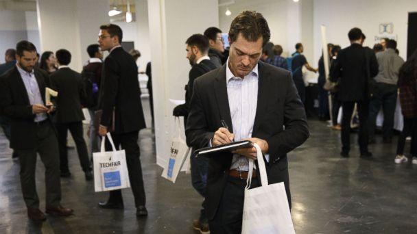 PHOTO: An job seeker holds a folder during the TechFair LA job fair in Los Angeles, Jan. 26, 2017.