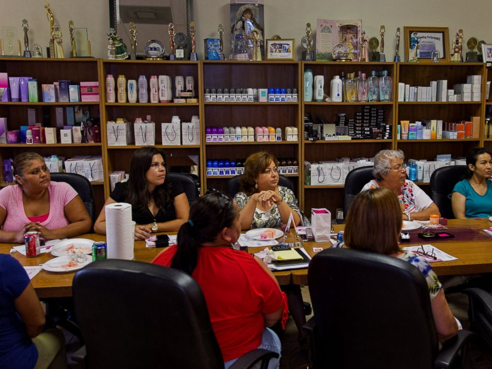 PHOTO: Isabel Hernandez, unit leader and independent sales representative for Avon Products Inc., center, attends a weekly sales meeting on Aug. 28, 2014 in McAllen, Texas.