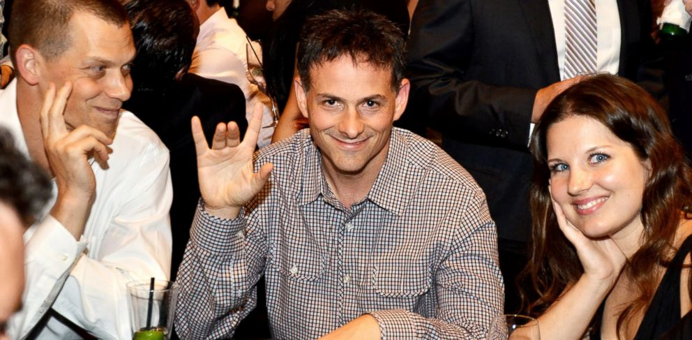 PHOTO: PHOTO: David Einhorn, center, president of Greenlight Capital Inc., attended the fourth annual Take Em To School Poker Tournament in New York, U.S., in this July 23, 2013, file photo.