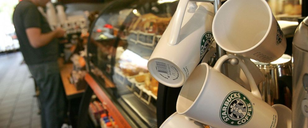 PHOTO: A customer pays for his purchase at a Starbucks store in Park Ridge, Illinois.