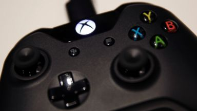 PHOTO: A logo sits on an Xbox One games controller, manufactured by Microsoft Corp., during the Euro-gamer Expo 2013 in London, U.K., Sept. 28, 2013.