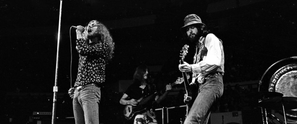 "PHOTO: Rock band ""Led Zeppelin"" performs onstage at the Forum on September 4, 1970 in Los Angeles, California. (L-R) Robert Plant, John Paul Jones, Jimmy Page."