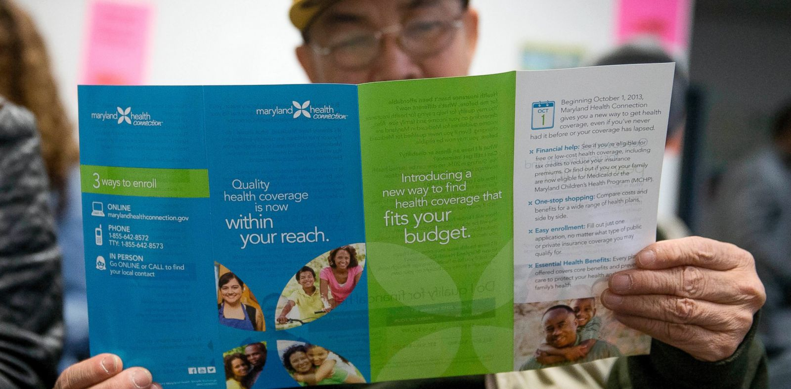 PHOTO: Sakoun Khanthanoua reads a Maryland Health Connection health insurance marketplace pamphlet while waiting to speak to a health navigator in Silver Spring, Md., Dec. 7, 2013.