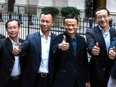 PHOTO: Executive Chairman of Alibaba Group Jack Ma (C) and other executives pose for a photo outside the New York Stock Exchange prior to the companys initial price offering (IPO), Sept. 19, 2014, in New York.