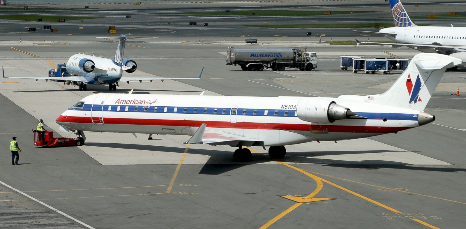 PHOTO: An American Airlines jet taxis on the runway at Laguardia Airport, Aug. 14, 2013, in New York.