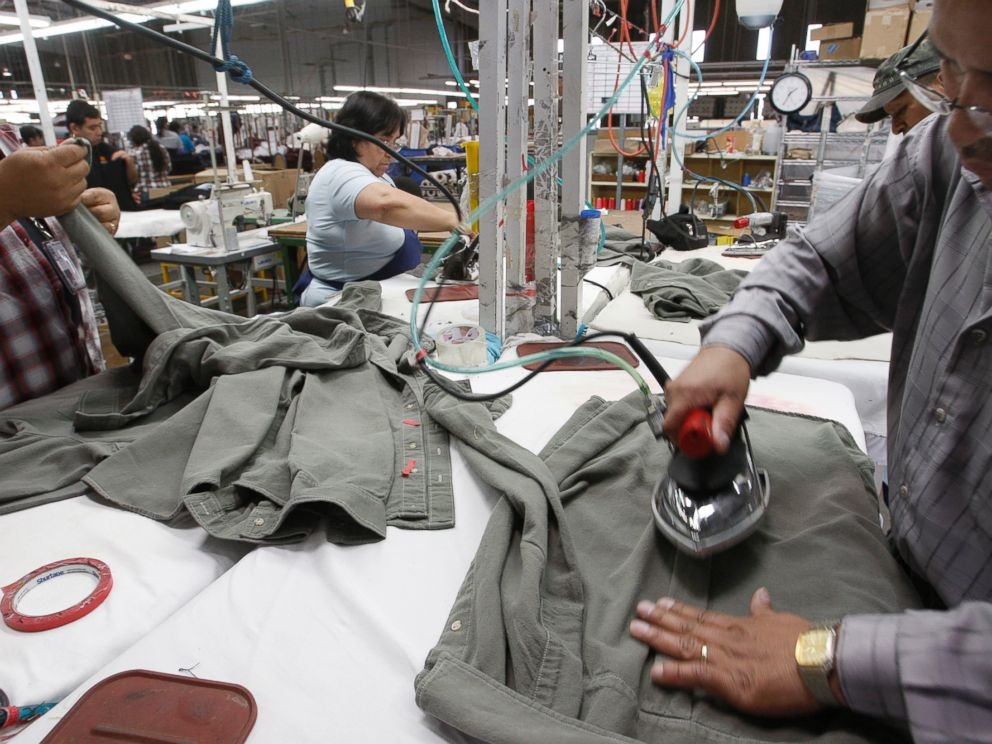 PHOTO: Workers iron shirts at the American Apparel factory in downtown Los Angeles, April 3, 2012.
