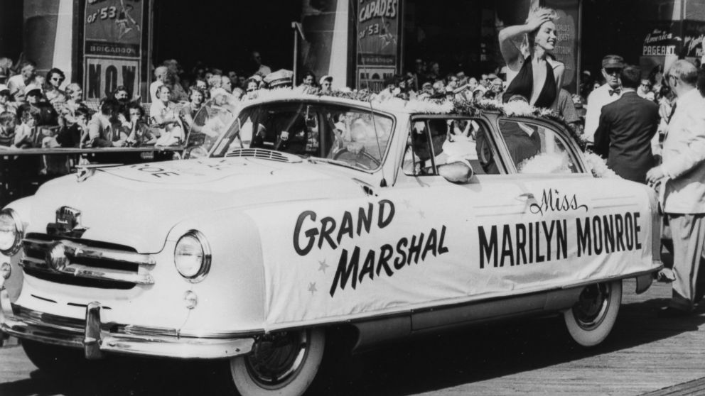 PHOTO: Marilyn Monroe plays grand marshal as she rides on the back of a convertible down the boardwalk during the Miss America Beauty Pageant parade, Sept. 1, 1952, in Atlantic City, N.J.