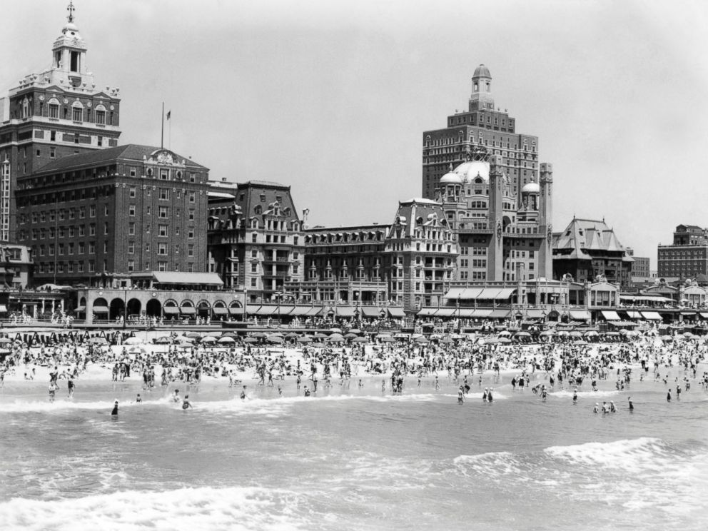 PHOTO: A crowded beach is seen with the boardwalk and hotels of Atlantic City, N.J. in the background, circa 1940s.