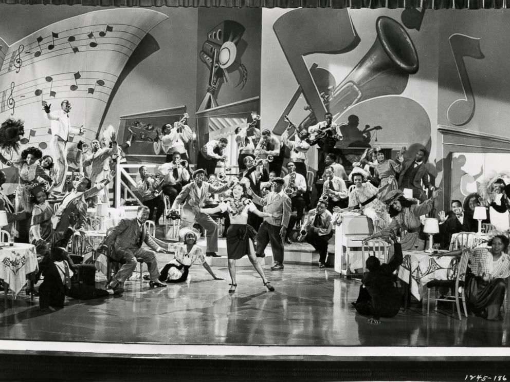 PHOTO: Publicity still of Dorothy Dandridge, Buck and Bubbles and Louis Armstrong on stage in the film Atlantic City, 1944