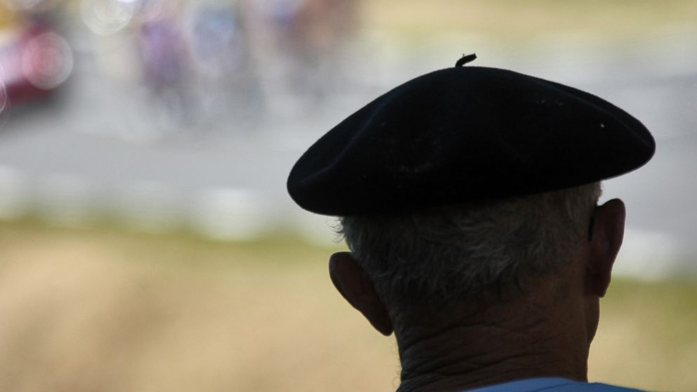 PHOTO: A cycling supporter wearing a beret watches the breakaway leaders during the 17th stage of the 94th Tour de France cycling race in this July 26, 2007, file photo.